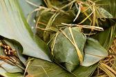 Rice dumpling on bamboo leaves — Stock Photo
