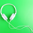 Headphone on green background — Stock Photo #26640827
