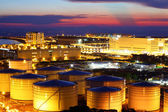 Oil tank in cargo service terminal at night — Stock Photo