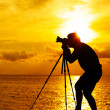 Silhouette photographer at sunset — Stock Photo