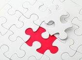 Puzzle with missing piece in red color — Stock Photo