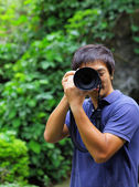 Asian man taking photo — Stock Photo