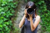 Asian woman taking photo — Stock Photo