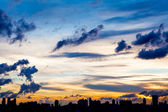City skyline silhouetted against a blue sunset — Stock Photo