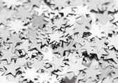 Scattered glittering stars confetti — Stock Photo