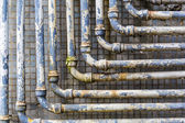 Series of parallel old pipes on wall — Stock Photo