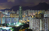 Kowloon area in Hong Kong at night with lion rock — Stock Photo