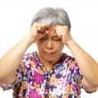 Mature asian woman serious headache — Stock Photo