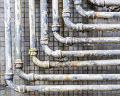 Old pipes on wall — Stock Photo