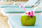 Sunbathing with coconut drink — Stock Photo