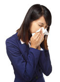 Cold sneezing asian business woman — Stock Photo
