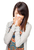 Cold sneezing asian woman — Stock Photo
