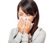 Sneezing woman isolated over white background — Stock Photo