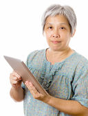 Asian old woman using tablet — Stock Photo