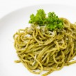 Italian pasta spaghetti with pesto sauce and basil leaf — Stock Photo