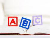 Alphabet block with ABC on book — Stock Photo