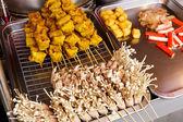 Thai style grilled food on market — Stock Photo