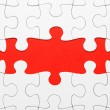 Stock Photo: Incomplete puzzle in red color