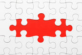 Incomplete puzzle in red color — Stock Photo