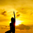 Woman doing yoga at sunset time — Stock Photo #30653999