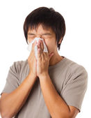 Sneezing asian man — Stock Photo