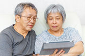 Asian elderly couple — Stock Photo