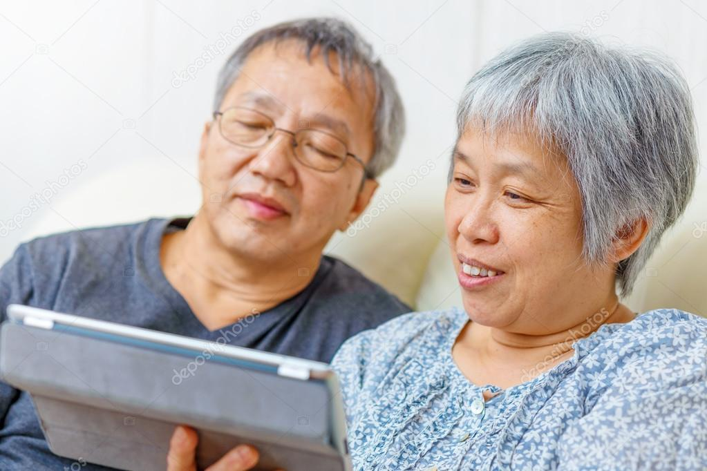 Elderly Using Facebook Asian Elderly Couple Using