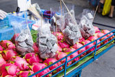 Dragon fruit on market stand — Stock Photo