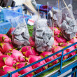 Stock Photo: Dragon fruit on market stand in Thailand