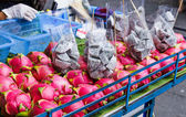 Dragon fruit on market stand in Thailand — Stock Photo