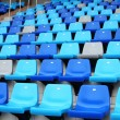 Blue plastic old stadium seats on concrete steps — Stock Photo #31388665
