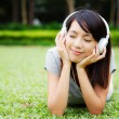 Asian woman enjoy music — Stock Photo