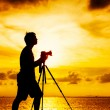 Silhouette of photographer at sunset — Stock Photo