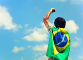 Excited man holding a brazil flag — Stock Photo