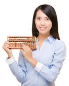 Asian woman holding abacus — Stock Photo