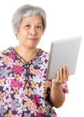 Asian old woman with digital tablet — Stock Photo