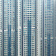Stock Photo: Overpopulated building in city