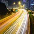 Busy traffic on highway at night — Stock Photo