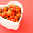 Foto Stock: Cherry tomato with love