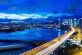 Hong Kong city with highway at night — Stockfoto
