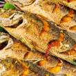 Stock Photo: Roasted fish for sell