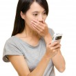 Asian woman shocking about the things on mobile — Stock Photo #32107691