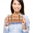 Asian woman and abacus — Stock Photo #32109623