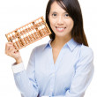 Asian woman and abacus — Stock Photo
