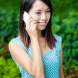 Asian woman talking phone at outdoor — Stock Photo