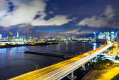 Hong Kong city with highway at night — Stok fotoğraf