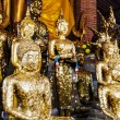 Stock Photo: Buddhstatue with gold foil in temple