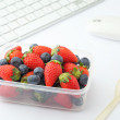 Healthy lunch box on working desk — Stock Photo