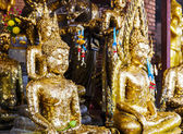 Golden foil on buddha statue — Stock Photo