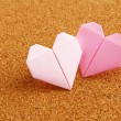 Origami colorful heart on corkboard — Stock Photo